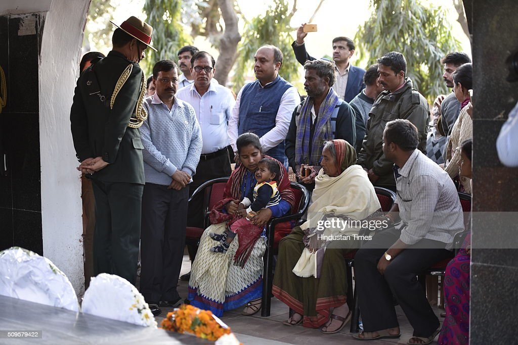 Vice-President of the Indian National Congress party, Rahul Gandhi, Defence Minister Manohar Parrikar and Delhi CM Arvind Kejriwal talk to the family members of Late Lance Naik Hanumanthappa during his funeral ceremony at Brar square crematorium on February 11, 2016 in New Delhi, India. Lance Naik Hanamanthappa Koppad of 19 Madras Regiment was rescued alive on night after being buried under 35 feet of snow for six days. The lone survivor of the February 3 Siachen avalanche that claimed the lives of nine soldiers, breathed his last at the Army RR Hospital in Delhi.