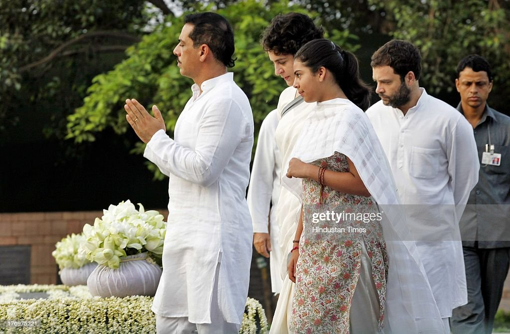 Vice President of the Indian National Congress Rahul Gandhi (R) and Priyanka Vadra along with her daughter Miraya Vadra and husband Robert Vadra pay tribute to former Indian Prime Minister Rajiv Gandhi on his birth anniversary at his memorial on August 20, 2013 in New Delhi, India. Rajiv Gandhi, who heralded the information and communication technology revolution in the country, was born on August 20, 1944 and served as the sixth Prime Minister of India from 1984-1989. He was assassinated by the LTTE on May 21, 1991 at Sriperumbudur in Tamil Nadu while addressing an election campaign.