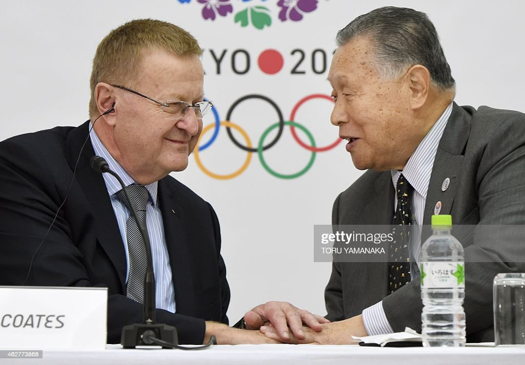 Vice President of the International Olympic Committee (IOC) <a gi-track='captionPersonalityLinkClicked' href=/galleries/search?phrase=John+Coates&family=editorial&specificpeople=233445 ng-click='$event.stopPropagation()'>John Coates</a> (L) shakes hands with President of the Tokyo 2020 Organising Committee Yoshiro Mori (R) during a press conference in Tokyo on February 5, 2015. The IOC and the Tokyo 2020 held the third project review on Wednesday and Thursday. AFP PHOTO / Toru YAMANAKA