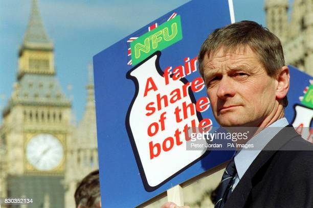 Vice President of the NFU Scotland John Kinnaird holds a placard in support of Dairy farmers outside the Houses of Parliament in London as part of...