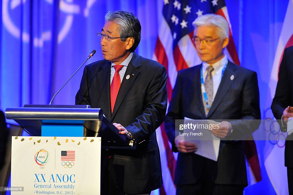 Vice President of the Tokyo 2020 Organizing Committee <a gi-track='captionPersonalityLinkClicked' href=/galleries/search?phrase=Tsunekazu+Takeda&family=editorial&specificpeople=2574573 ng-click='$event.stopPropagation()'>Tsunekazu Takeda</a> speaks on the final day of the XX ANOC General Assembly 2015 while IOC President Thomas Bach looks on at the Hilton Hotel on October 30, 2015 in Washington, DC.