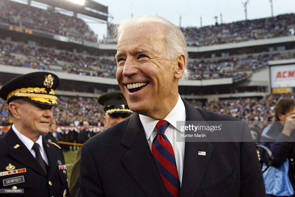 Vice President of the United States Joe Biden smiles as he stands at midfield during the coin toss before a game between the Army Black Knights and the Navy Midshipmen on December 8, 2012 at Lincoln Financial Field in Philadelphia, Pennsylvania.
