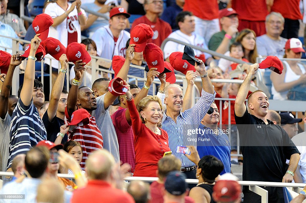 Vice President of the United States Joe Biden waves to the crowd during a military salute in between innings of the game between the Philadelphia Phillies and the Washington Nationals at Nationals Park on July 31, 2012 in Washington, DC.