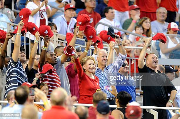 Vice President of the United States Joe Biden waves to the crowd during a military salute in between innings of the game between the Philadelphia...