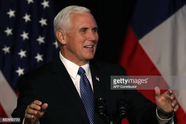 Vice President of the United States Mike Pence delivers a speech during a business dinner in Santiago on August 16 2017 Pence arrives in Santiago to...