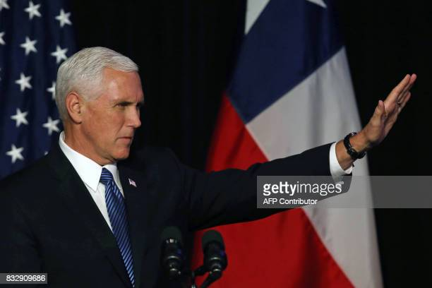 Vice President of the United States Mike Pence gestures during a business dinner in Santiago on August 16 2017 Pence arrives in Santiago to begin a...