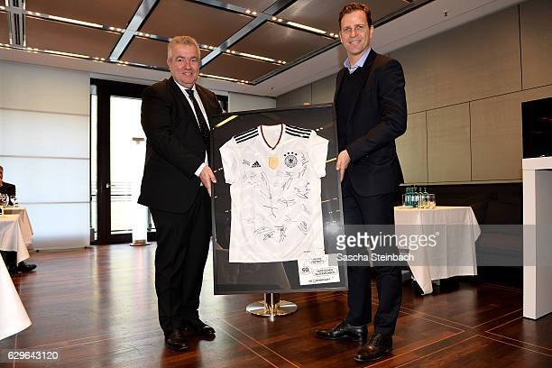 DFB vice president Peter Frymuth and Oliver Bierhoff pose during Peter Frymuth's 60th birthday matinee on December 14 2016 in Duesseldorf Germany