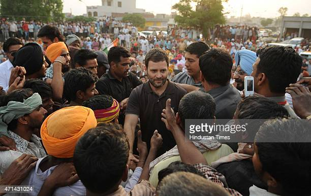 Vice President Rahul Gandhi interacting with farmers listening to their grievances at Sirhind grain market on April 28 2015 in Punjab India The...