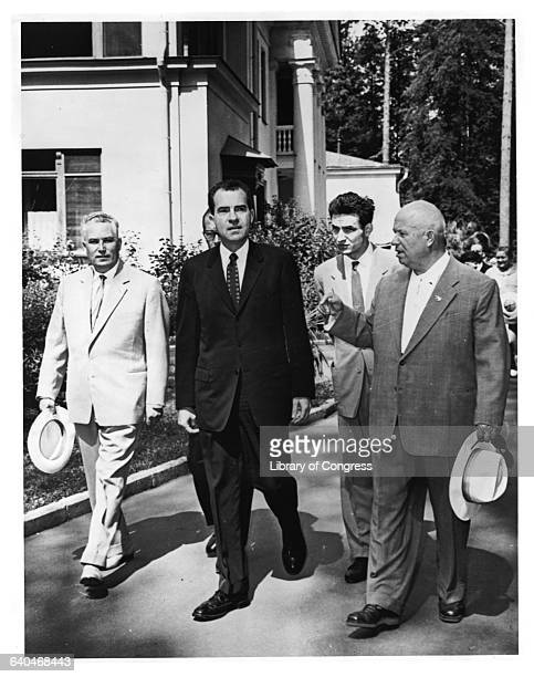 Vice President Richard Nixon and Premier Nikita Khrushchev walking together during a state visit in which the informal 'Kitchen Debate' took place