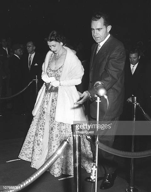 Vice President Richard Nixon escorts Britain's Queen Elizabeth II to an unspecified event October 20 1957