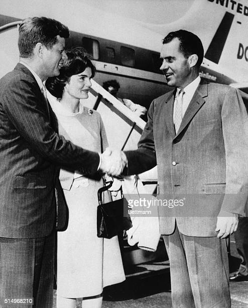 Vice President Richard Nixon shakes hands with Sen and Mrs John F Kennedy of Massachusetts as they change planes at Midway airport Nixon was waiting...