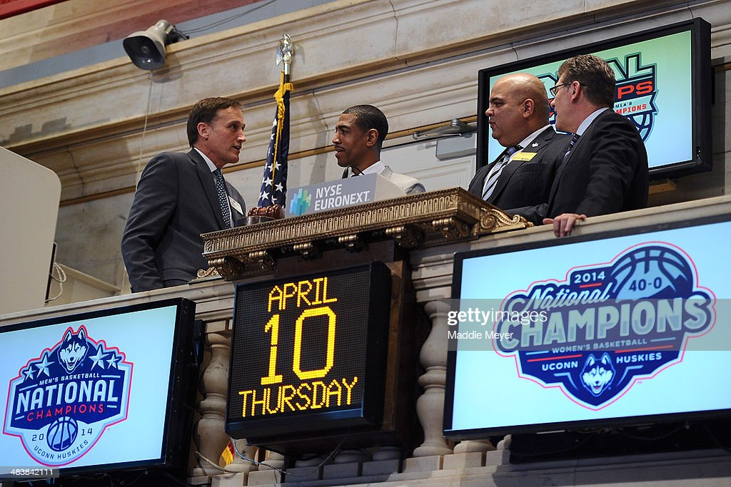 Vice President Robert Power, Connecticut Huskies Men's basketball Coach Kevin Ollie, University of Connecticut Director of Athletics Warde Manuel, and Connecticut Huskies Women's basketball coach Geno Auriemma talk together after ringing the closing bell at New York Stock Exchange on April 10, 2014 in New York City.