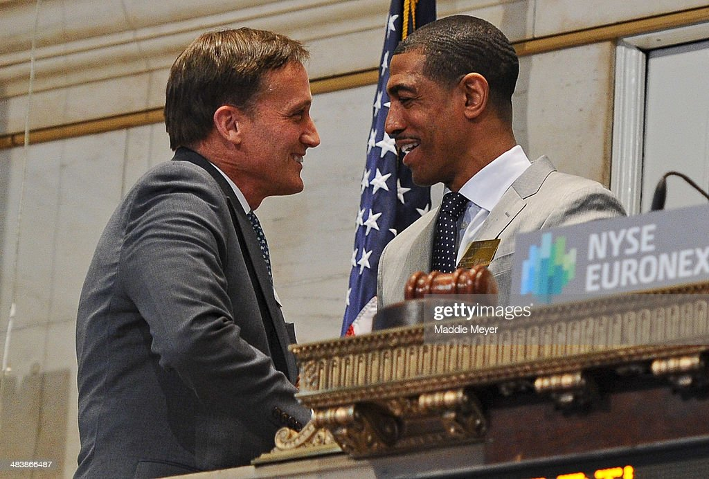 Vice President Robert Power shakes hands with Connecticut Huskies Men's Basketball coach <a gi-track='captionPersonalityLinkClicked' href=/galleries/search?phrase=Kevin+Ollie&family=editorial&specificpeople=202896 ng-click='$event.stopPropagation()'>Kevin Ollie</a> after ringing the closing bell at New York Stock Exchange on April 10, 2014 in New York City.