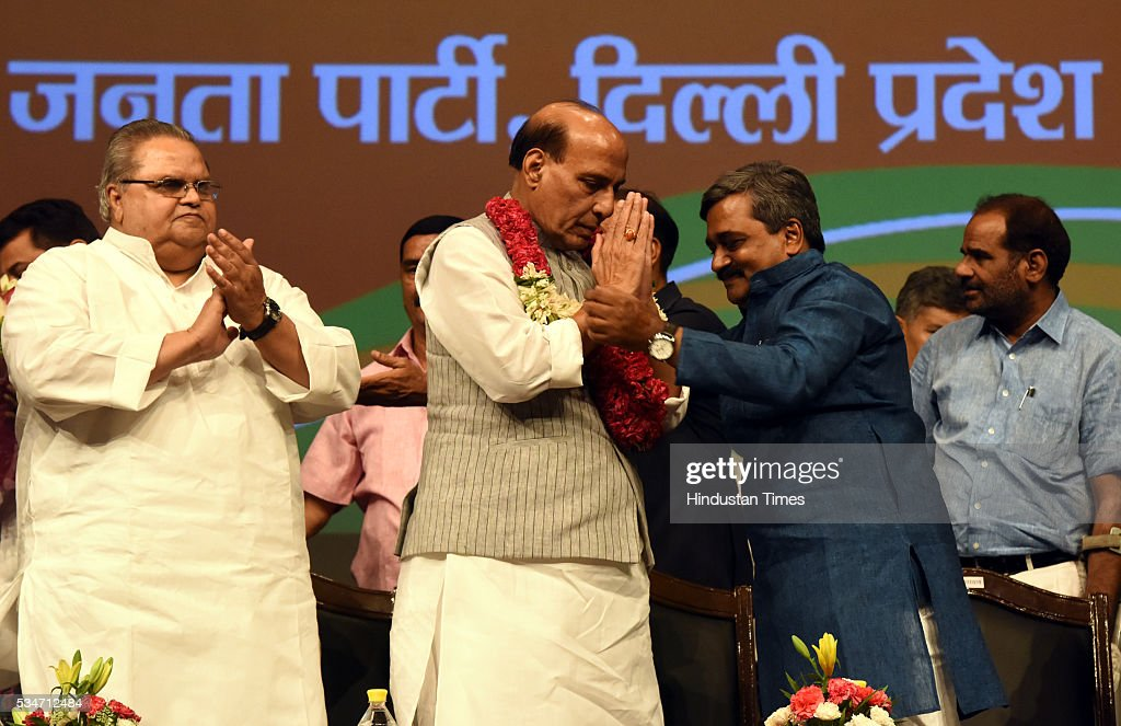 BJP Vice President Satpal Mallik, Delhi BJP President Satish Upadhyay being facilated to the Union Home Minister Rajnath Singh, during the Vikas Parv Function to celebrate the completion of second successful year of the Central Government headed by Prime Minister Narendra Modi at Siri Fort Auditorium on May 27, 2016 in New Delhi, India.