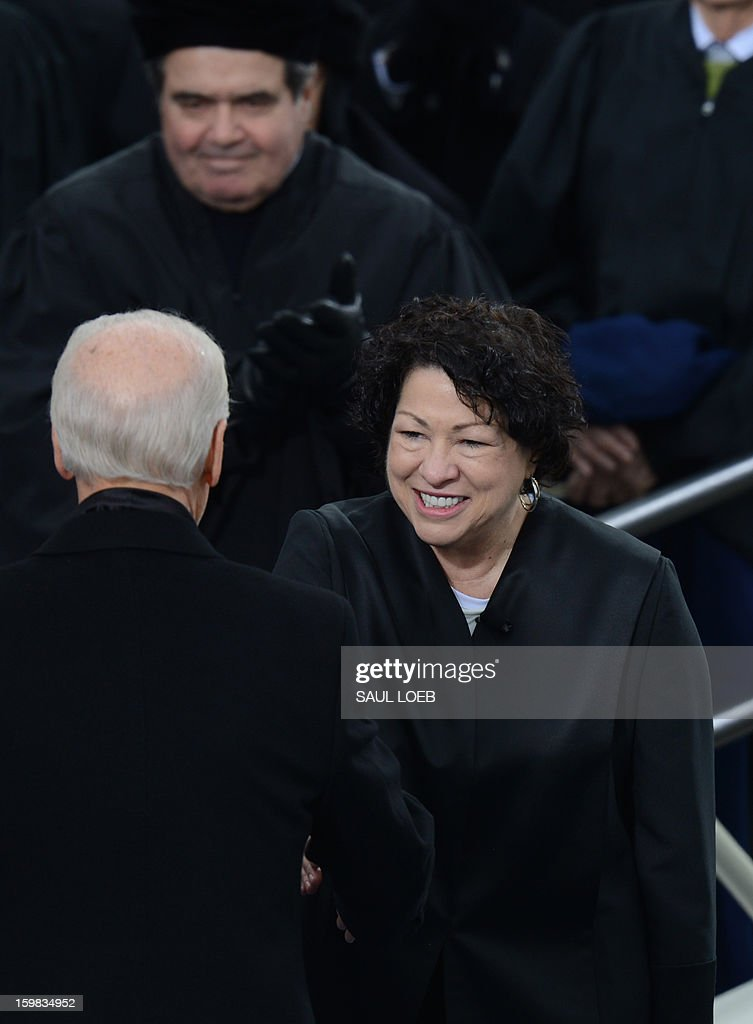 US Vice President shakes hands at his oath of office during the 57th Presidential Inauguration ceremonial swearing-in at the US Capitol on January 21, 2013 in Washington, DC. The oath was administered by US Supreme Court Associate Justice Sonia Sotomayor (R). AFP PHOTO / Saul LOEB