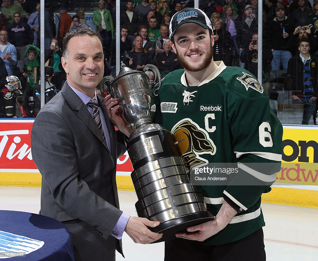 Vice President Ted Baker presents the Wayne Gretzky trophy to Scott Harrington #6 of the London Knights after defeating the Plymouth Whalers in game five of the Western Conference Final on April 26, 2013 at the Budweiser Gardens in London, Ontario, Canada. The Knights defeated the Whalers 5-4 in overtime to win the series 4 games to 1.