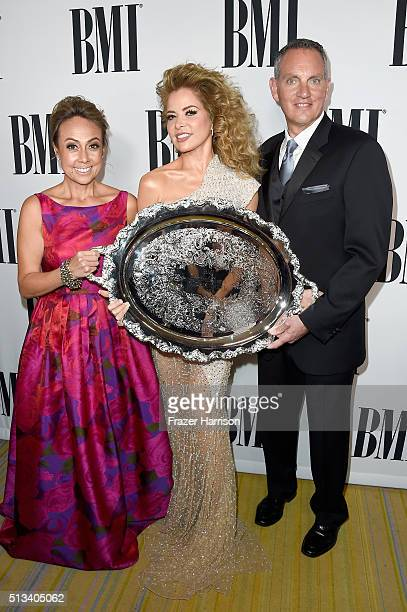 BMI Vice President Writer/Publisher Relations Latin Music Delia Orjuela honoree Gloria Trevi with the 2016 BMI President's Award and BMI President...