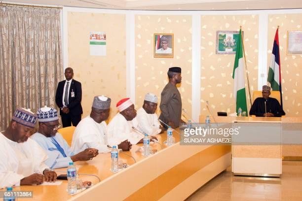 Vice President Yemi Osinbajo briefs Nigerian President Mohammadu Buhari prior his address at members of his cabinet upon his arrival at the...