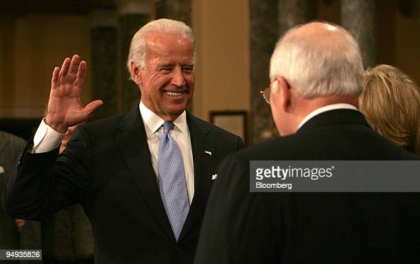 Vice Presidentelect Joseph Biden left takes the oath of office from current Vice President Dick Cheney at a mock swearing in session of Senators in...