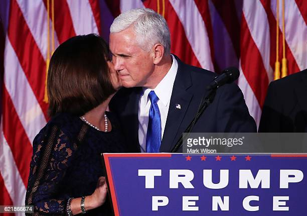 Vice presidentelect Mike Pence and his wife Karen Pence embrace at Republican presidentelect Donald Trump's election night event at the New York...