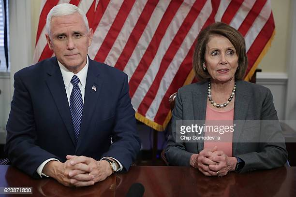 Vice Presidentelect Mike Pence and House Minority Leader Nancy Pelosi pose for photographs and talk to reporters following their meeting in her...