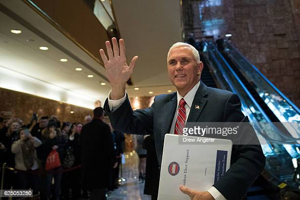 Vice Presidentelect Mike Pence arrives at Trump Tower November 22 2016 in New York City Presidentelect Donald Trump and his transition team are in...