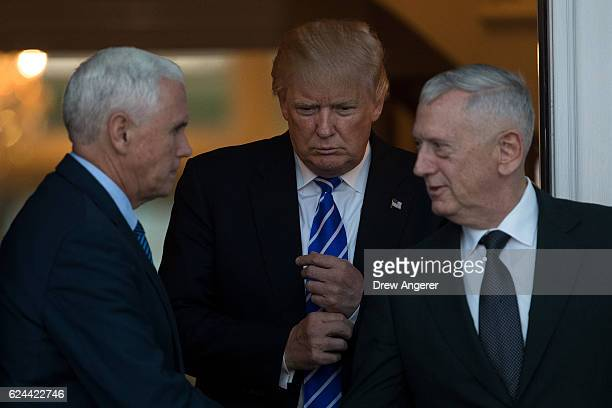 Vice presidentelect Mike Pence Presidentelect Donald Trump and retired United States Marine Corps general James Mattis exit the clubhouse after their...
