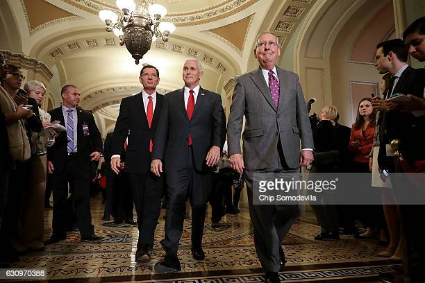 S Vice Presidentelect Mike Pence Senate Majority Leader Mitch McConnell and Sen John Barrasso arrive for a news conference in the US Capitol January...