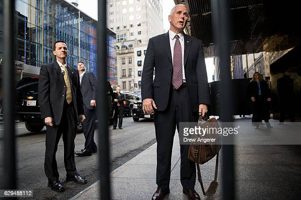 Vice Presidentelect Mike Pence speaks briefly to reporters as he arrives at Trump Tower December 13 2016 in New York City Presidentelect Donald Trump...