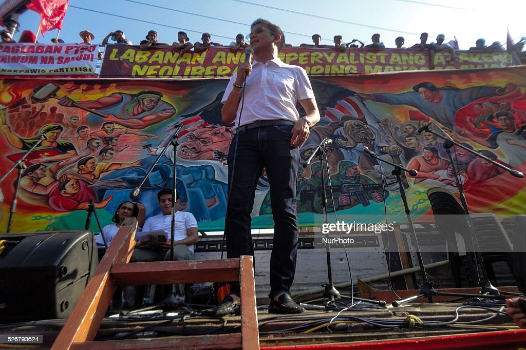 "Vice presidential candidate Senator Francis ""Chiz"" Escudero speaks before protesters during a rally commemorating Labor Day in Manila on Sunday, May 1, 2016. Thousands of protesters marched to protest the government's labour policy and demand higher wages amid rising prices for basic commodities."