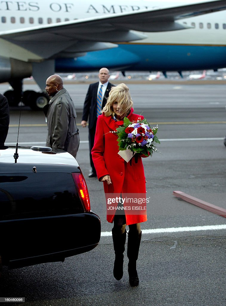 US Vice President's wife Jill Biden wears flowers upon arrival at the Tegel military airport in Berlin on February 1, 2013. US Vice President Joe Biden arrived in Germany to meet Chancellor Angela Merkel for talks ahead of the Munich Security Conference. EISELE
