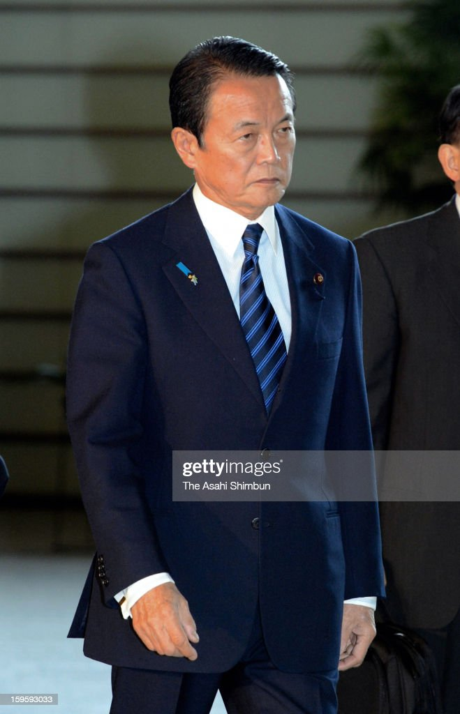 Vice Prime Minister and Foreign Minister Taro Aso enters to Prime Minister Shinzo Abe's official residence on January 17, 2013 in Tokyo, Japan. Islamic armed group in Algeria are holding foreign hostage, including Japanese.