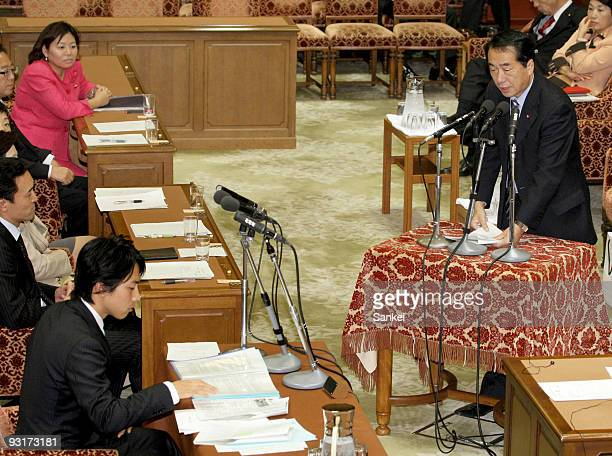 Vice Prime Minister Naoto Kan answers questions from Shinjiro Koizumi at the Lower House Cabinet Committee at the lower house building on November 18...