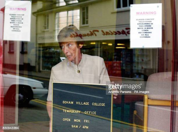Vice Principal Margaret Bryden of Soham Village College puts up a temporary office sign which has just opened in the High St of Soham Cambridgeshire...