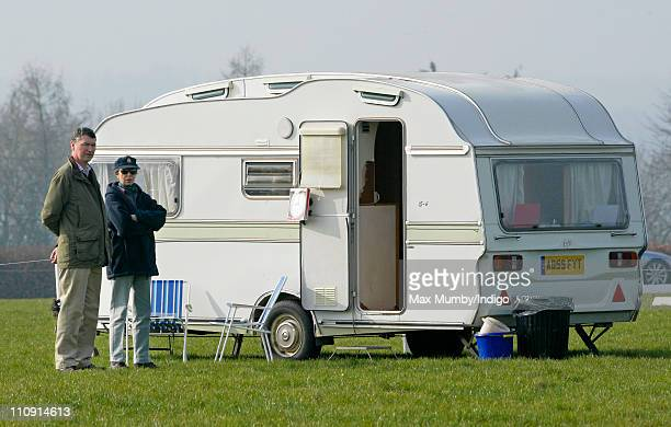 ViceAdmiral Tim Laurence and his wife Princess Anne The Princess Royal stand by the organisers caravan as they attend the Gatcombe Park Horse Trials...