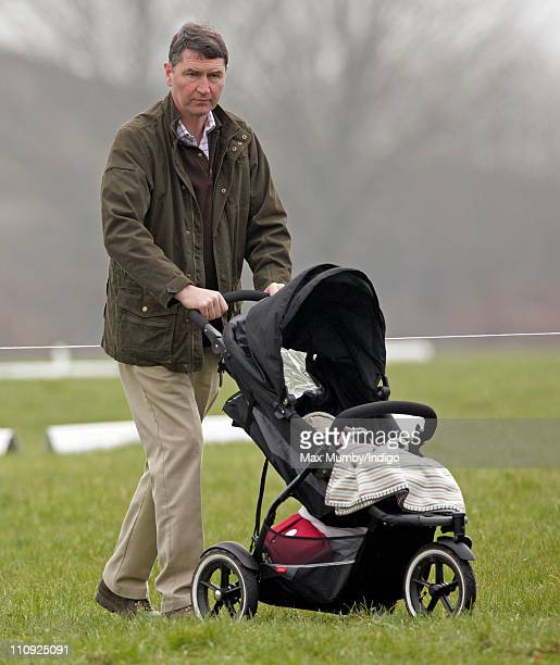 ViceAdmiral Tim Laurence pushes his step granddaughter Savannah Phillips in her pushchair as they attend the Gatcombe Park Horse Trials on March 26...