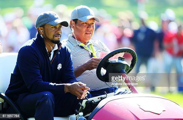 Vicecaptain Tiger Woods of the United States and Notah Begay III look on during afternoon fourball matches of the 2016 Ryder Cup at Hazeltine...