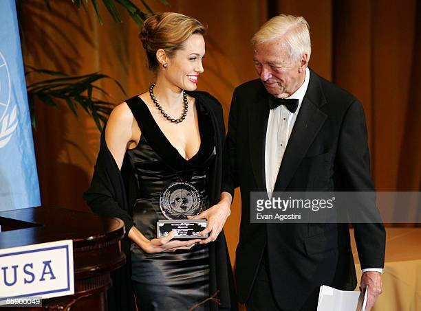 ViceChairman John Whitehead presents actress Angelina Jolie with the Global Humanitarian Award at the United Nations Association of the United States...
