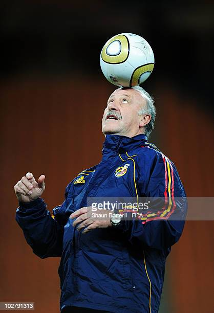Vicente del Bosque head coach of Spain balances a ball on his head during a Spain training session ahead of the 2010 FIFA World Cup Final at Soccer...