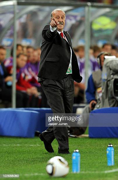 Vicente del Bosque head coach of Spain directs his team during the 2010 FIFA World Cup South Africa Semi Final match between Germany and Spain at...