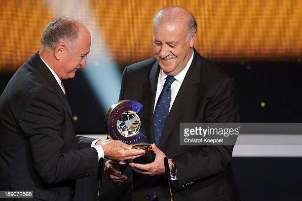 Vicente del Bosque head coach of Spain receives the FIFA World Coach of Men's Football 2012 trophy by Felipe Scolari at Congress House on January 7...