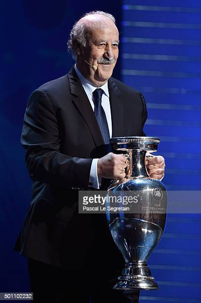 Vicente del Bosque Manager of Defending Champion Spain shows the European Championship Trophy during the UEFA Euro 2016 Final Draw Ceremony at Palais...