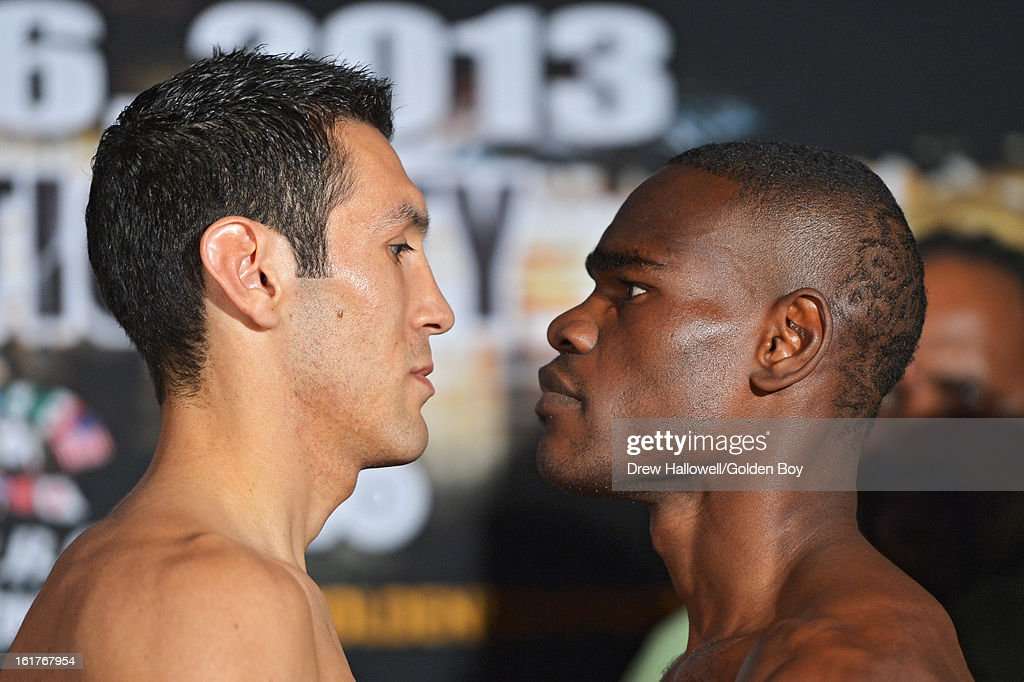 Vicente Escobedo and Edner Cherry stare at each other during weigh-in before the WBC Lightweight World Championship at Caesars Atlantic City on February 15, 2013 in Atlantic City, New Jersey.