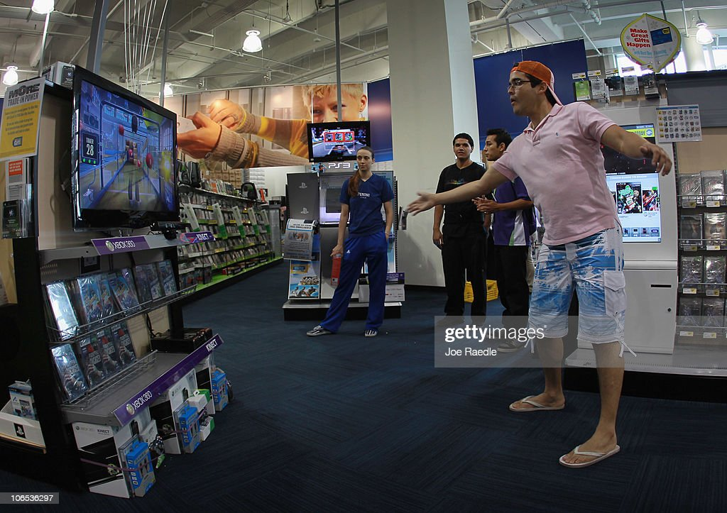 Vicente Galarza plays a game with Microsoft's new Kinect controller for the Xbox 360 at the Best Buy store on November 4, 2010 in Miami Beach, Florida. The Kinect went on sale today and uses sensors to read the players body language so controllers are not necessary to play Xbox games with the Kinect.