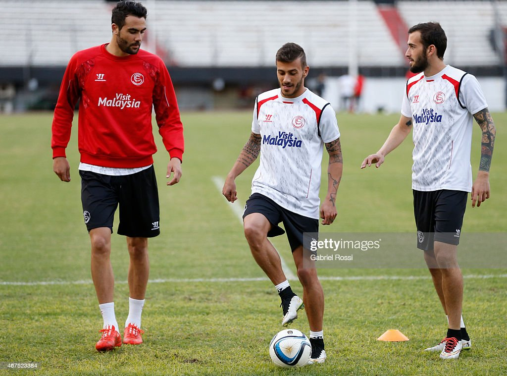 Vicente Iborra de la Fuente, Diogo Figueiras and Aleix Vidal of Sevilla FC talk during a training session at Monumental Antonio Vespucio Liberti Stadium on March 25, 2015 in Buenos Aires, Argentina. Sevilla FC will face River Plate on March 26 at Monumental Antonio Vespucio Liberti Stadium as part of Supercopa Euroamericana.