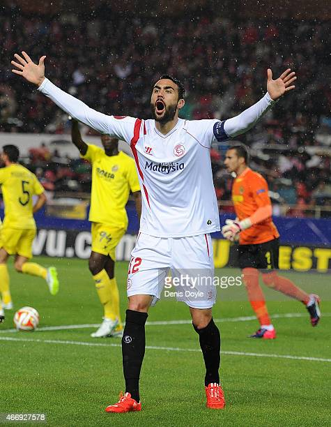 Vicente Iborra of FC Sevilla disagrees with the linesman's decision during the UEFA Europa League Round of 16 Second Leg match between FC Sevilla and...