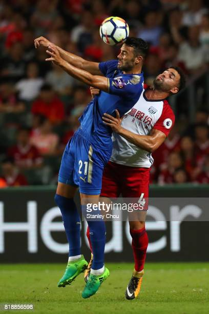 Vicente Iborra of Leicester City challenges Hal RobsonKanu of West Bromwich during the Premier League Asia Trophy match between Leicester City and...