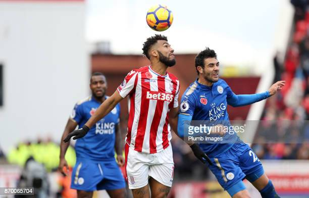 Vicente Iborra of Leicester City in action with Maxim ChoupoMoting of Stoke City during the Premier League match between Stoke City and Leicester...