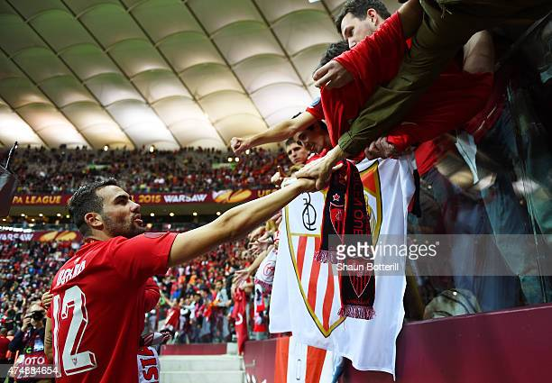 Vicente Iborra of Sevilla celebrates victory with fans after the UEFA Europa League Final match between FC Dnipro Dnipropetrovsk and FC Sevilla on...