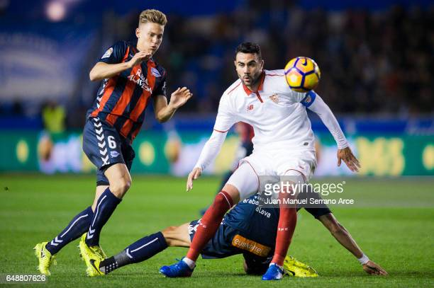 Vicente Iborra of Sevilla FC duels for the ball with Marcos Llorente of Deportivo Alaves during the La Liga match between Deportivo Alaves and...